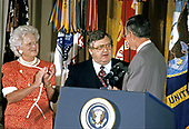 United States President George H.W. Bush and first lady Barbara Bush present the Presidential Citizens Medal to United States Deputy Secretary of State Lawrence Eagleburger during a ceremony in the East Room of the White House in Washington, DC on July 3, 1991. Eagleburger is being honored for his efforts to ensure the success of Operation Desert Shield / Operation Desert Storm and the liberation of Kuwait.<br /> Credit: Ron Sachs / CNP