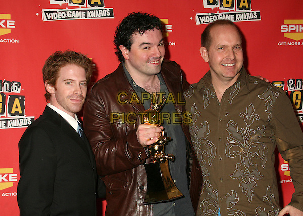 SETH GREEN, SETH MacFARLANE & MIKE HENRY.Spike TV's 2006 Video Game Awards at the Galen Center - Press Room, Los Angeles, California, USA..December 8th, 2006.half length black shirt award trophy brown leather jacket.CAP/ADM/BP.©Byron Purvis/AdMedia/Capital Pictures