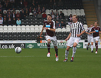 Marc McAusland plays the ball back as Callum Paterson chases in the St Mirren v Heart of Midlothian Clydesdale Bank Scottish Premier League match played at St Mirren Park, Paisley on 15.9.12.