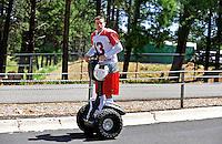 Jul 31, 2009; Flagstaff, AZ, USA; Arizona Cardinals quarterback Kurt Warner rides a segway scooter following the morning training camp session on the campus of Northern Arizona University. Mandatory Credit: Mark J. Rebilas-