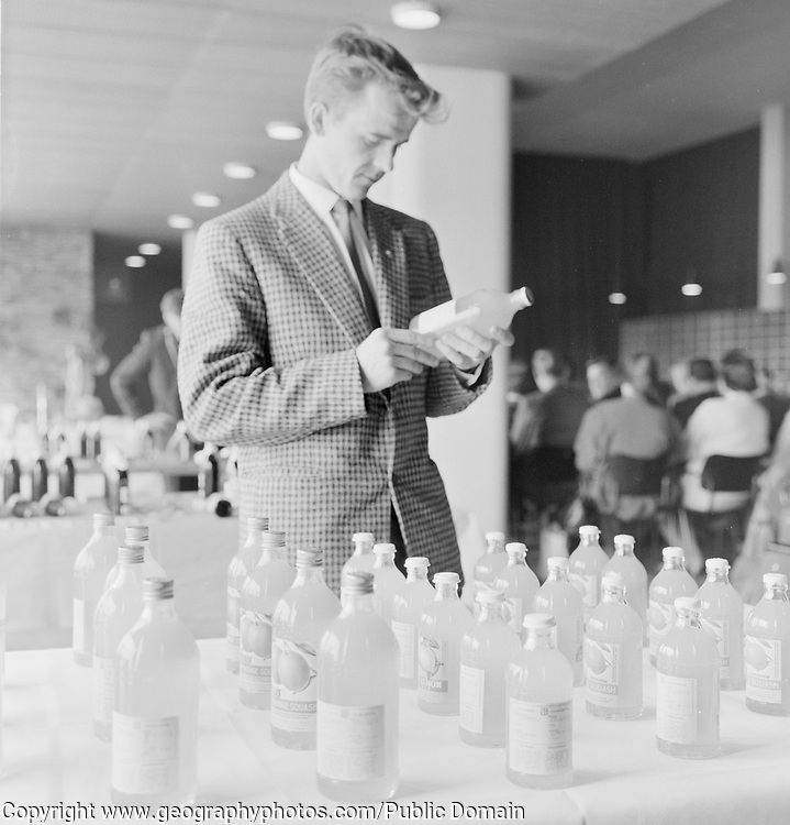 Man with bottles of soft drink manufactured in a  factory, Finland 1959