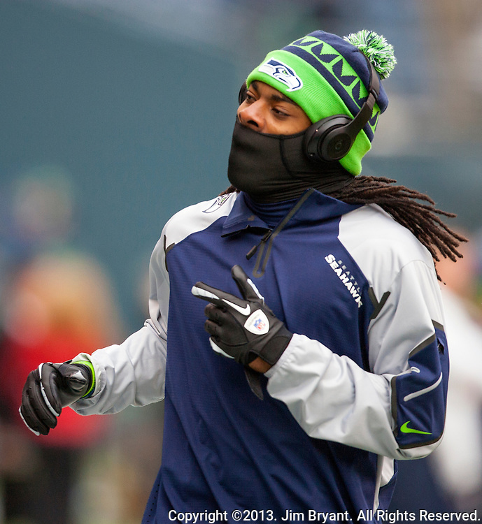 Seattle Seahawks cornerback Richard Sherman warmups before their  game against the St. Louis Rams at CenturyLink Field in Seattle, Washington on December 29, 2013.  Seahawks clinched the NFC West title and home-field advantage throughout the playoffs with a 27-9 victory over the St. Louis Rams. ©2013. Jim Bryant Photo. ALL RIGHTS RESERVED.