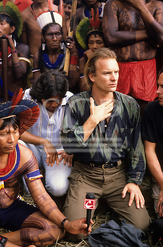 Amazon, Brazil. Sting at Altamira meeting, Payakan with microphone, Marcos Terena and Kayapo Warriors.