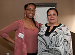 WATERBURY, CT-052417JS30-  Dana Evora and Denise Martinez, both with New Opportunities in Waterbury, at a celebration of volunteers who participated in the VITA (Volunteer Income Tax) program, at the United Way of Greater Waterbury. <br /> Jim Shannon Republican-American