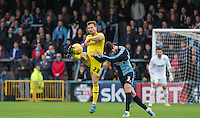 Chris Maguire of Oxford United beats the incoming Joe Jacobson of Wycombe Wanderers to the ball during the Sky Bet League 2 match between Wycombe Wanderers and Oxford United at Adams Park, High Wycombe, England on 19 December 2015. Photo by Andy Rowland.