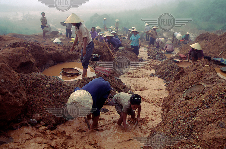 People (mainly women and children) work at a tin mine in Quy Hop.