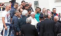 Papa Francesco saluta un gruppo di detenuti del carcere di Viterbo al termine dell'udienza generale del mercoledi' in Piazza San Pietro, Citta' del Vaticano, 7 maggio 2014.<br /> Pope Francis greets a group of inmates of Viterbo's prison at the end of his weekly general audience in St. Peter's Square at the Vatican, 7 May 2014.<br /> UPDATE IMAGES PRESS/Isabella Bonotto<br /> <br /> STRICTLY ONLY FOR EDITORIAL USE