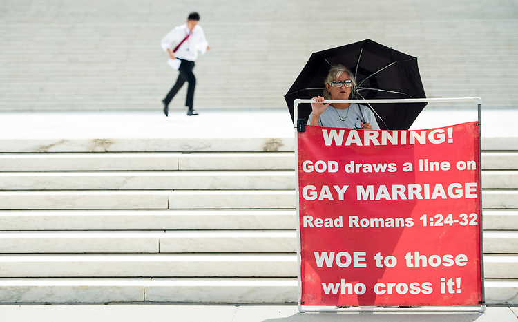 UNITED STATES - JUNE 18: A runner for one of the television news networks races with papers to the camera positions outside of the Supreme Court in Washington on Thursday, June 18, 2015. The court upheld the right of the state of Texas to reject Confererate flag license plates. The court did not hand down rulings on gay marriage, Obamacare or the death penalty. (Photo By Bill Clark/CQ Roll Call)