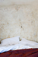 The walls of this bedroom have been rendered in rough plaster