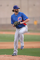 Justin Berg #64 of the Chicago Cubs participates in pitchers fielding practice during spring training workouts at the Cubs complex on February 19, 2011  in Mesa, Arizona. .Photo by Bill Mitchell / Four Seam Images.