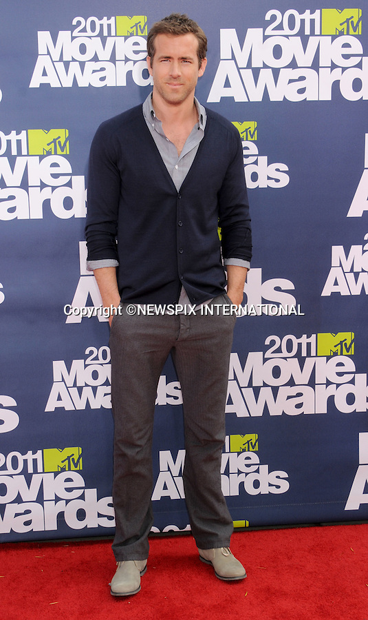 """RYAN REYNOLDS.attends the 2011 MTV Movie Awards at the Gibson Amphitheatre on June 5, 2011 in Universal City, California.Mandatory Photo Credit: ©Crosby/Newspix International. .**ALL FEES PAYABLE TO: """"NEWSPIX INTERNATIONAL""""**..PHOTO CREDIT MANDATORY!!: NEWSPIX INTERNATIONAL(Failure to credit will incur a surcharge of 100% of reproduction fees)..IMMEDIATE CONFIRMATION OF USAGE REQUIRED:.Newspix International, 31 Chinnery Hill, Bishop's Stortford, ENGLAND CM23 3PS.Tel:+441279 324672  ; Fax: +441279656877.Mobile:  0777568 1153.e-mail: info@newspixinternational.co.uk"""