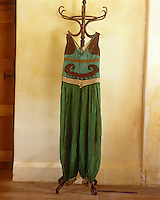 """A blue and green costume designed for the Ballet """"Thamar"""" in 1912 is decorated with panels of bronze and gold ribbon around the trouser cuffs"""