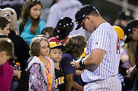Corey Zangari (14) of the Kannapolis Intimidators signs autographs for fans following the game against the Hagerstown Suns at Kannapolis Intimidators Stadium on May 6, 2016 in Kannapolis, North Carolina.  The Intimidators defeated the Suns 5-3.  (Brian Westerholt/Four Seam Images)