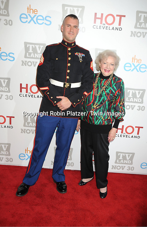 "Sargeant Eric Worth and Betty White attend the TV Land Party for the  premieres of ""Hot In Cleveland"" and ""The Exes""  on November 29, 2011 at SD26 in New York City. the party also celebrated Toys for Tots."