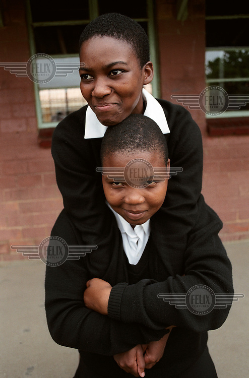 Two pupils are pictured during a break at Zwelibanzi High School in Umlazi Township.