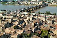 The Pont de Pierre over the Garonne river and surrounding city, Bordeaux, Gironde, France.