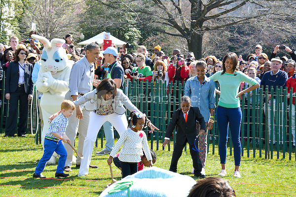 WASHINGTON, DC - April 1: (L-R) Singer Jessica Sanchez, daughter Malia, US President Barack, First Lady Michelle Obama, Benny and Kid President Robbie Novak during National Anthem the 2013 Easter Egg Roll at The White House South Lawn in Washington, DC on April 1, 2013. RTNSykes / MediaPunch Inc