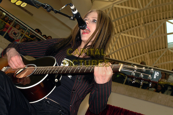"AVRIL LAVIGNE.Strongsville, OH, USA;  performs at the Shoppingtown Southpark Mall in Strongsville, Ohio as a part of the ""Top Secret Mall Tour""..March 24th, 2004.half length, guitar, music, stage, singing, guitar.www.capitapictures.com.sales@capitalpictures.com.©Jason Nelson/AdMedia /Capital Pictures"