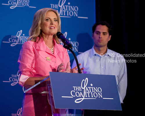 Ann Romney Attends the Latino Coalition Luncheon during the 2012 Republican National Convention in Tampa Bay, Florida on Tuesday, August 28, 2012.  Her  youngest son, Craig Romney, listens at right..Credit: Ron Sachs / CNP.(RESTRICTION: NO New York or New Jersey Newspapers or newspapers within a 75 mile radius of New York City)
