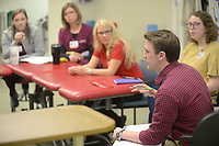 NWA Democrat-Gazette/ANDY SHUPE<br /> James McGee (right), a biomedical engineering student at the University of Arkansas, speaks Tuesday, April 10, 2018, to clinicians as she and other students present ideas for solutions to everyday problems health care providers encounter during a meeting with staff at the UAMS outpatient therapy clinic in Fayetteville.