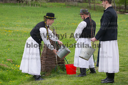 Boys load their buckets with water as they prepare for the Easter celebration in the Skansen open air ethnographic museum in Szenna (about 200 km South-West of capital city Budapest), Hungary on April 14, 2017. ATTILA VOLGYI