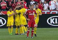 18 May 2013: The Columbus Crew celebrate the game's only goal by Columbus Crew foward/midfielder Dominic Oduro #11during an MLS game between the Columbus Crew and Toronto FC at BMO Field in Toronto, Ontario Canada..The Columbus Crew won 1-0...