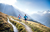 Trail running along a bisse in Verbier on day one of the Via Valais, a multi-day running tour connecting Verbier and Zermatt, Switzerland.