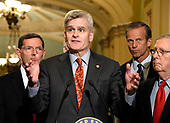 United States Senator Bill Cassidy (Republican of Louisiana) speaks to reporters outside the US Senate Chamber following the Republican weekly luncheon caucus in the US Capitol in Washington, DC on Tuesday, September 19, 2017.  The GOP leadership is advocating for the passage of the Graham-Cassidy Act that would replace parts of the Affordable Care Act (also known as ObamaCare) with block grants for the individual states.  From left to right: US Senator John Barrasso (Republican of Wyoming), Senator Cassidy, US Senator John Thune (Republican of South Dakota), and US Senate Majority Leader Mitch McConnell (Republican of Kentucky).<br /> Credit: Ron Sachs / CNP