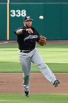 """Reno's third baseman Josh Bell throws to first as the Aces are transformed into the Reno Ghost Riders for the """"What Could Have Been Weekend"""" series against the Salt Lake Bees on Thursday night July 12, 2012 at Aces Ballpark in Reno, NV."""