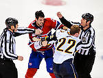 14 December 2009: Montreal Canadiens' defenseman Ryan O'Byrne picks a fight with Buffalo Sabres center Adam Mair in the opening minute of the second period at the Bell Centre in Montreal, Quebec, Canada. The Sabres defeated the Canadiens 4-3. Mandatory Credit: Ed Wolfstein Photo