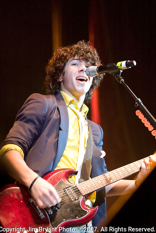 """Nick Jonas of the Jonas Brothers performs one of their hits """"Games"""" during the 10th Annual Jingle Bell Bash at the Tacoma Dome in Tacoma, WA., on December 4, 2007.Jim Bryant Photo. ©2007. All Rights Reserved."""