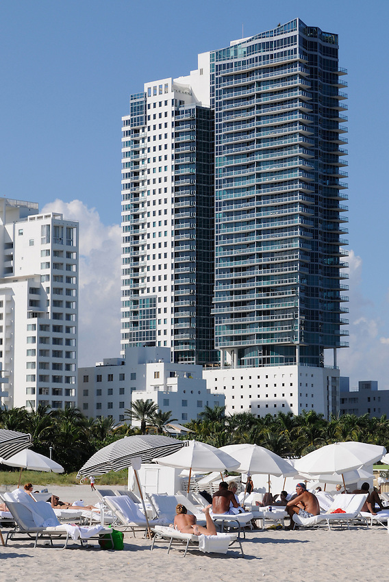 Elegant women basking in the afternoon sun at beautiful South Beach, Miami Beach Florida.