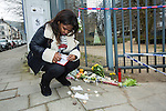 BRUSSELS - BELGIUM - 23 March 2016 -- Belgium in mourning after the terrorist attack in Maelbeek metro station - EU quarters, and the Brussels airport in Zaventem. -- Garla Helena Silva Gomes leaving candles and notes close to the Maelbeek metro station. She, her mother and sister changed their mind at the last minute and decided to take a passing taxi at the metro station instead of going by metro at the time of the explosion. -- PHOTO: Juha ROININEN / EUP-IMAGES