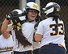 Sydney Tamburello #24 of Massapequa, center, gets congratulated by teammates Amanda Considine #1, left, and Jenna Morales #33 after connecting for a two-run home run to right field in the top of the fourth inning of Game 2 of the Nassau County varsity softball Class AA semifinals against host East Meadow High School on Tuesday, May 17, 2016.