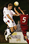 22 January 2006: US forward Taylor Twellman (20) heads the ball over the crossbar over the defense of Canada's Marco Reda (5). The United States Men's National Team tied Canada 0-0 at Torero Stadium in San Diego, California in an International Friendly soccer match.