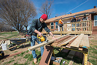 NWA Democrat-Gazette/J.T. WAMPLER Danny Snodgrass of Springdale works Monday March 5, 2018 with a crew from A-1-Acoustics to build a deck on the back of a house owned by the Springdale Parks Department at J.B. Hunt Park. The house, located at 2315 Lewis Ave., will be the home of Dynamic Discs Northwest Arkansas with a grand opening scheduled for April 21. The disc golf shop with be the fourth of its kind nationally with a planned disc golf driving range,, junior course and eventually a new 18-hole championship level course.