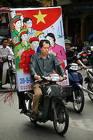 Man on motorbike with posters relating to election for National Assembly held May 20th 2007. Array