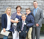 David Rothwell with his family on communion day.