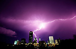 OKLAHOMA CITY, OK - 1999: A burst of lightning hits the top of a building in 1999 in Oklahoma City, Oklahoma (Photo By Donald Miralle)