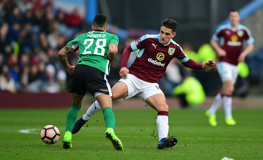 Lincoln City's Nathan Arnold is fouled by Burnley's Ashley Westwood<br /> <br /> Photographer Chris Vaughan/CameraSport<br /> <br /> Emirates FA Cup Fifth Round - Burnley v Lincoln City - Saturday 18th February 2017 - Turf Moor - Burnley <br />  <br /> World Copyright &copy; 2017 CameraSport. All rights reserved. 43 Linden Ave. Countesthorpe. Leicester. England. LE8 5PG - Tel: +44 (0) 116 277 4147 - admin@camerasport.com - www.camerasport.com