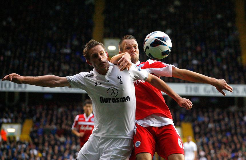 Tottenham Hotspur's Gylfi Sigurdsson battles with Queens Park Rangers' Clint Hill ..Football - Barclays Premiership - Tottenham Hotspur v Queens Park Rangers - Sunday 23rd September 2012 - White Hart Lane - London..