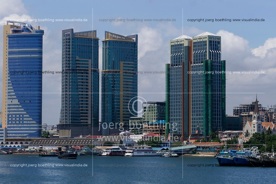 TANZANIA Daressalaam, bay, new apartment tower, Azam ferry terminal and catholic St. Joseph cathedral, built during german colonial time