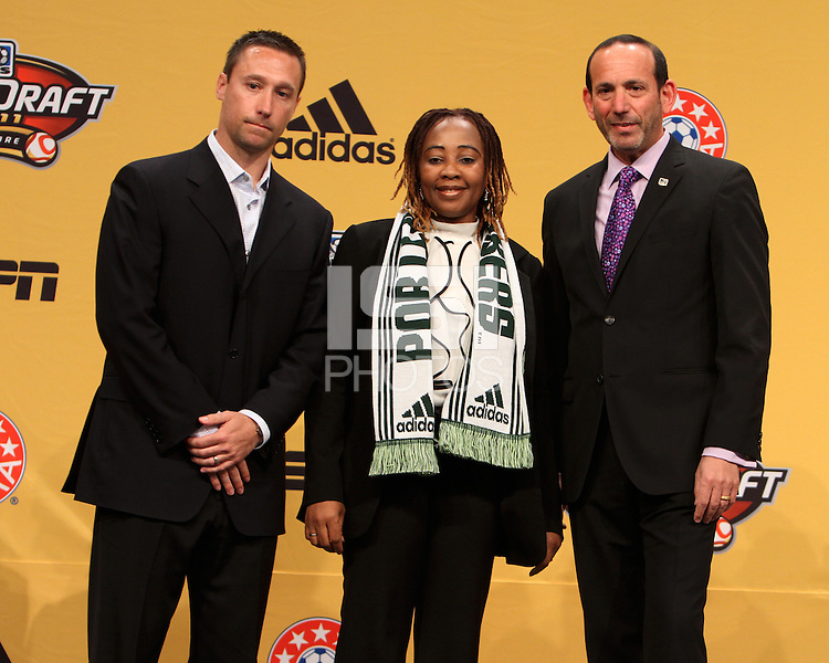 Caleb Porter and Don Garber with the mother of Darlington Nagbe at the 2011 MLS Superdraft, in Baltimore, Maryland on January 13, 2010.
