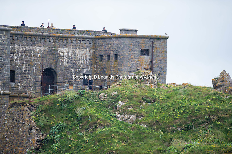 Tuesday  28 June 2016<br /> Pictured: Cast members with guns on the island <br /> Re: Sherlock filming on St.Catherines Island, Wales, UK