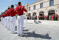 NWA Democrat-Gazette/DAVID GOTTSCHALK  Jim and Joyce Faulkner (center) listen to members of the Razorback Marching Band play Friday, September 18, 2015 in front of the new Jim and Joyce Faulkner Performing Arts Center following a  a ribbon cutting ceremony on the campus in Fayetteville. Jim and Joyce Faulkner made a $6 million donation to the university in 2012 specifically toward renovating and remodeling the Field House into a performing arts center.
