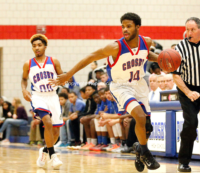 Waterbury, CT- 13 January 2016-011316CM03- action man----   Crosby's Tyairus Sands takes the ball up court  during their NVL matchup against Holy Cross in Waterbury on Wednesday.  Crosby would go onto win, 66-59.   Christopher Massa Republican-American