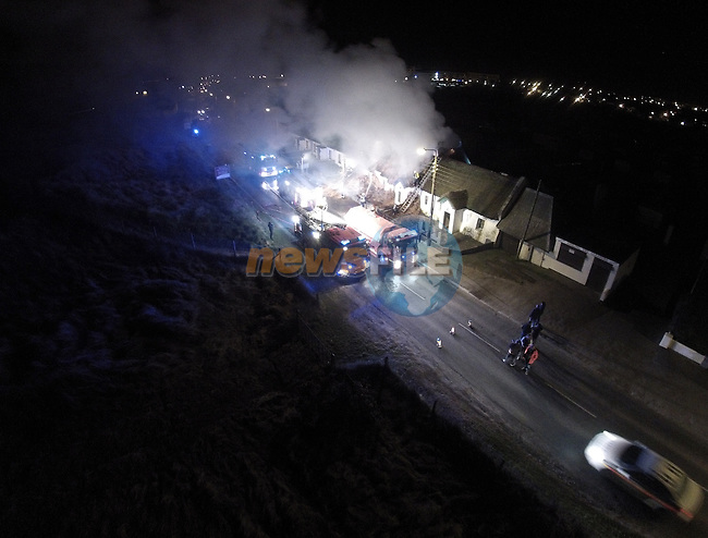 Fire engulfed a tatch cottage on the golf Links road in Bettystown. Fire units from Drogheda, Balbriggan and two appliances from Navan attended the scene of the fire.<br /> Picture www.newsfile.ie