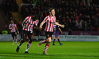 Lincoln City's Shay McCartan, right, celebrates scoring the opening goal with team-mate John Akinde<br /> <br /> Photographer Chris Vaughan/CameraSport<br /> <br /> The EFL Sky Bet League Two - Lincoln City v Port Vale - Tuesday 1st January 2019 - Sincil Bank - Lincoln<br /> <br /> World Copyright &copy; 2019 CameraSport. All rights reserved. 43 Linden Ave. Countesthorpe. Leicester. England. LE8 5PG - Tel: +44 (0) 116 277 4147 - admin@camerasport.com - www.camerasport.com