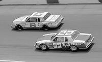 Country singer Marty Robbins'  #22 buick regal races under the #6 Buick Regal of Dr. Bob Jarvis during the Firecracker 400 Daytona International Speedway Daytona Beach FL July 1982.(Photo by Brian Cleary/www.bcpix.com)(Photo by Brian Cleary/www.bcpix.com)