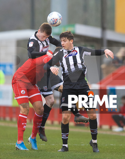 Harry Clifton of Grimsby Town wins the header during the Sky Bet League 2 match between Crawley Town and Grimsby Town at The People's Pension Stadium, Crawley, England on 25 January 2020. Photo by Alan  Stanford / PRiME Media Images.